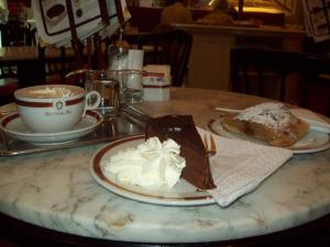 Enjoy cake, coffee and streudel inside one of Vienna's coffeehouses such as Cafe Sacher.