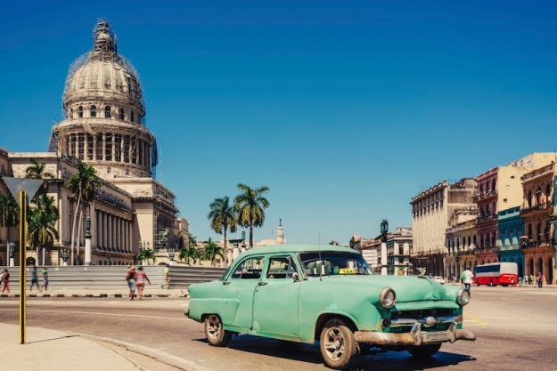 old-green-american-car-on-havana-street-istock-64822809